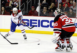 Jan 22, 2010; Newark, NJ, USA; Montreal Canadiens center Maxim Lapierre (40) takes a shot on New Jersey Devils goalie Martin Brodeur (30) during the second period at the Prudential Center.