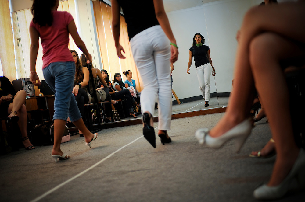 "Students attend ""Catwalk, Elegance, Protocol and Etiquette"" class at Gisselle's International Models school in Caracas, Venezuela..The majority of girls that attend the school dream of becoming future Miss Venezuelas or models..The school is highly acclaimed and run by former Miss Venezuela, Gisselle Reyes."