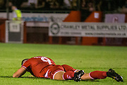 Ollie Palmer (Crawley Town) knocked his head a few times on the pitch in frustration during the EFL Cup match between Crawley Town and Norwich City at The People's Pension Stadium, Crawley, England on 27 August 2019.