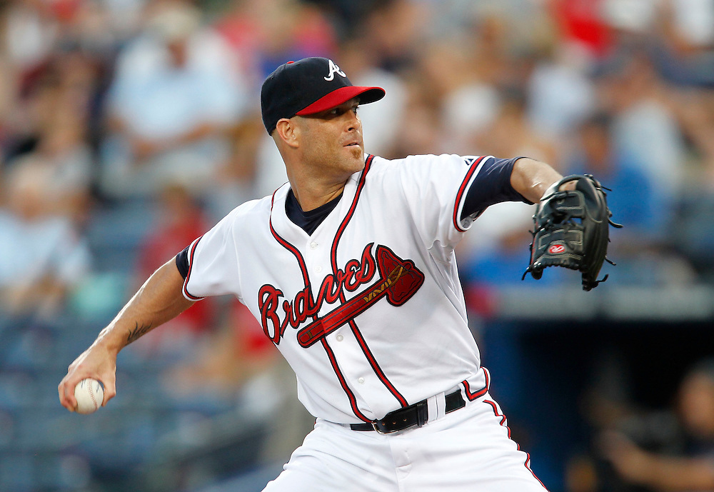 ATLANTA - AUGUST 7:  PItcher Tim Hudson #15 of the Atlanta Braves throws a pitch during the game against the San Francisco Giants at Turner Field on August 7, 2010 in Atlanta, Georgia.  (Photo by Mike Zarrilli/Getty Images)