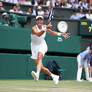 LONDON, ENGLAND - JULY 13:  Garbine Muguruza of Spain in action against Magdalena Rybarikova of Slovakia in the Ladies Singles Semi Final match during the Wimbledon Lawn Tennis Championships at the All England Lawn Tennis and Croquet Club at Wimbledon on July 13, 2017 in London, England. (Photo by Tim Clayton/Corbis via Getty Images)