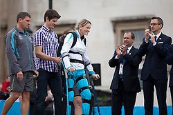 © Licensed to London News Pictures. 24/08/2012. LONDON, UK. Claire Lomas walks using a robotic suit as she prepares to light the Paralympic Cauldron in Trafalgar Square today (24/08/12). Ms Lomas, formerly a horse event rider, was paralysed from the chest down after being injured during the Osberton Horse Trials and completed the London Marathon in 2012. Photo credit: Matt Cetti-Roberts/LNP