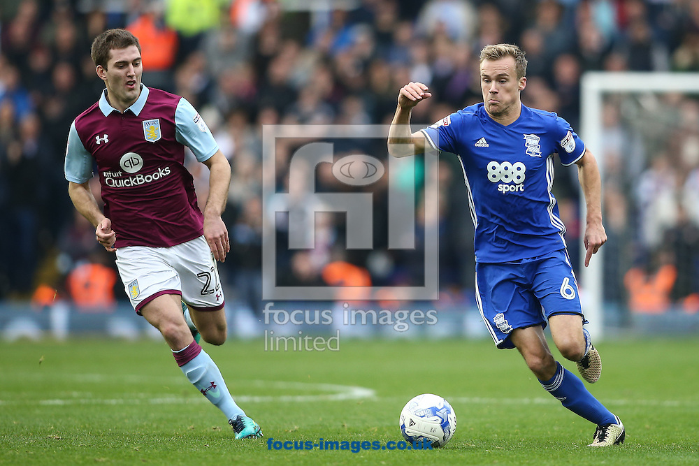 Maikel Kieftenbeld of Birmingham City (right) competing with Gary Gardner of Aston Villa (left) during the Sky Bet Championship match at St Andrews, Birmingham<br /> Picture by Andy Kearns/Focus Images Ltd 0781 864 4264<br /> 30/10/2016