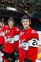 KAMLOOPS, CANADA - NOVEMBER 5: Josh Brook #2 and Ty Smith #24 of Team WHL smile at the camera as they line up against the Team Russia  on November 5, 2018 at Sandman Centre in Kamloops, British Columbia, Canada.  (Photo by Marissa Baecker/Shoot the Breeze)