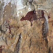 Prehistoric colour drawings on the summit of Khao Pla Ra in Uthai Thani, Thailand. The drawings, aged between 3000 and 5000 years old, show an agrarian society and are artistic expressions of people in ancient times. The drawings give insight into their lifestyle and homesteads. They are invaluable as artistic heritage of Thailand.