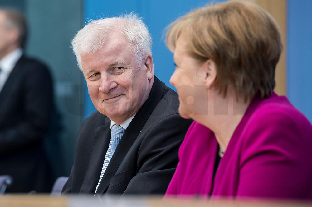 12 MAR 2018, BERLIN/GERMANY:<br /> Horst Seehofer (L), CSU, desig. Bundesinnenminister, Angela Merkel (R), CDU, Bundeskanzlerin, waehrend einer Pressekonferenz zum Koalitionsvertrag der CDU/CSU und SPD, Bundespressekonferenz<br /> IMAGE: 20180312-01-012