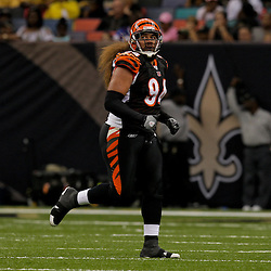 2009 August 14: Cincinnati Bengals defensive tackle Domata Peko (94) runs to the sideline during a preseason opener between the Cincinnati Bengals and the New Orleans Saints at the Louisiana Superdome in New Orleans, Louisiana.
