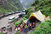 Children finish a lesson in a tent school Pragya have set up They rush to the next class run from the education bus next to a road in the Himalayas, India.  The migrant community is given education and information support by the Pragya organization who have a project helping in high altitude areas across the Himalayas.