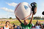 Wesley Henry holds on to an Inflatable souvenir baseball that he caught as members of Families Through Korean Adoption (FTKA) enjoy watching the Madison Mallards take on the Wisconsin Woodchucks during a baseball game at Warner Park in Madison, Wis., on July 9, 2016. (Photo by Jeff Miller, www.jeffmillerphotography.com)