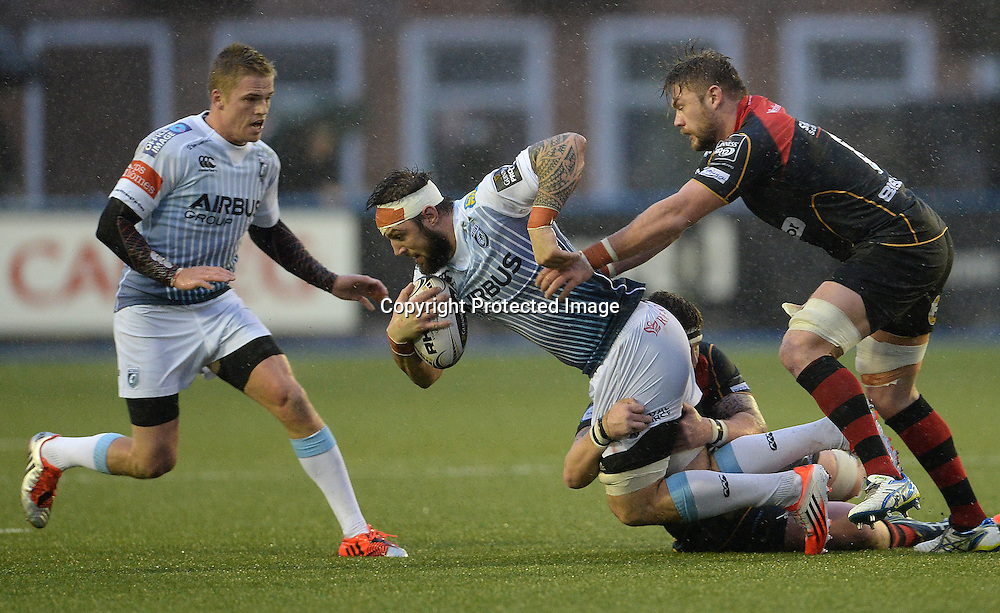 Guinness PRO12, BT Sport Cardiff Arms Park, Cardiff 26/12/2014<br /> Cardiff Blues vs Newport Gwent Dragons<br /> Cardiff Blues Josh Turnbull is tackled by Newport Gwent Dragons Phil Price<br /> Mandatory Credit &copy;INPHO/CameraSport/Ian Cook