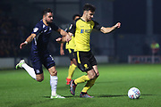 Scott Fraser goes past Stephen McLaughlin during the EFL Sky Bet League 1 match between Burton Albion and Southend United at the Pirelli Stadium, Burton upon Trent, England on 3 December 2019.