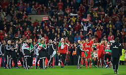 CARDIFF, WALES - Tuesday, October 13, 2015: Wales' players and supporters celebrate qualifying for the finals after the 2-0 victory over Andorra during the UEFA Euro 2016 qualifying Group B match at the Cardiff City Stadium. (Pic by Barry Coombs/Propaganda)