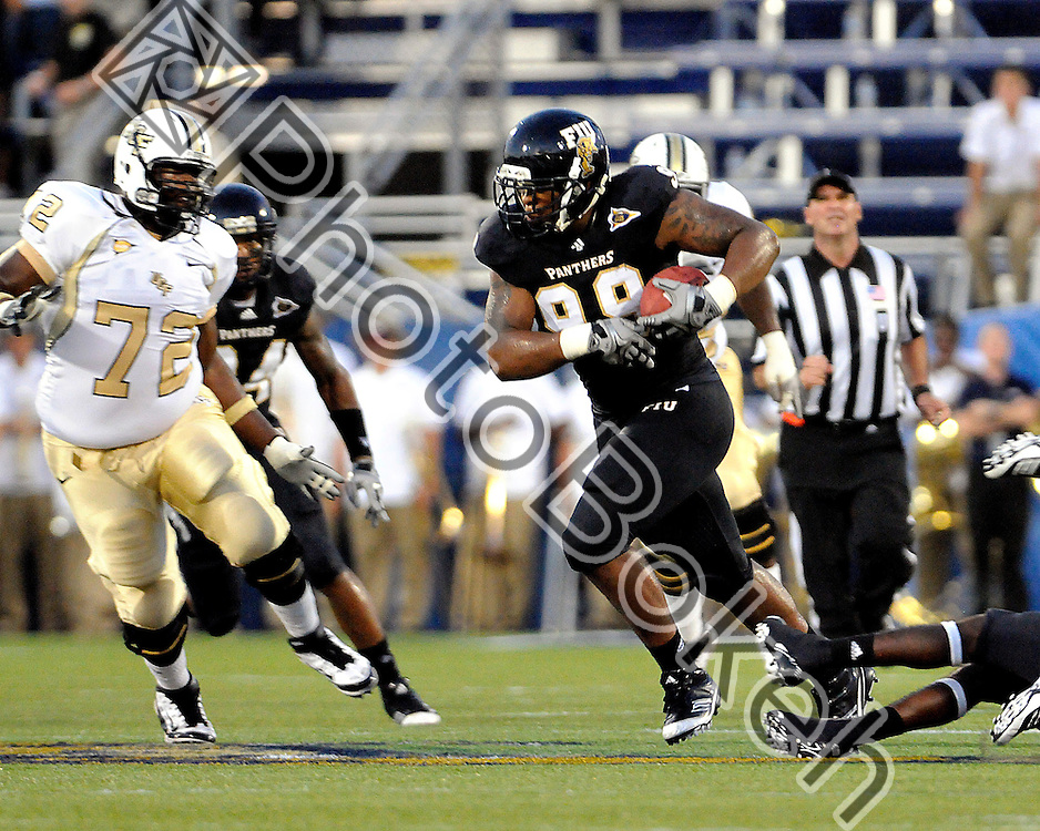 2011 September 17 - Florida International defensive line Isame Faciane (99) recovering a fumble and running back for a touchdown. Florida International University Golden Panthers defeated the Golden Knights of the University of Central Florida, 17-10, at the FIU Football Stadium, Miami, Florida. (Photo by: www.photobokeh.com / Alex J. Hernandez)