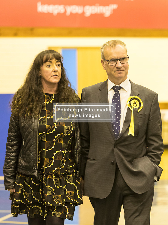 The count for the UK Parliamentary General Election 2017 for the Perth & North Perthshire Constituency takes place at Bell's Sports Centre in Perth.<br /> <br /> The four candidates standing for the seat are Peter Barrett (Scottish Liberal Democrats), Ian Duncan (Scottish Conservatives), David Roemmele (Scottish Labour) and Pete Wishart (SNP)<br /> <br /> <br /> Pictured: Pete Wishart and his partner Sara O'Hagan after a re-count is declared at Perth and North Perthshire