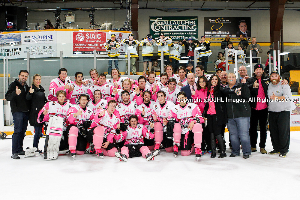 AURORA, ON - Oct 23, 2015 : Ontario Junior Hockey League game action between Newmarket and Aurora, the 2015 Pink in the Rink Aurora Tigers.<br /> (Photo by Brian Watts / OJHL Images)