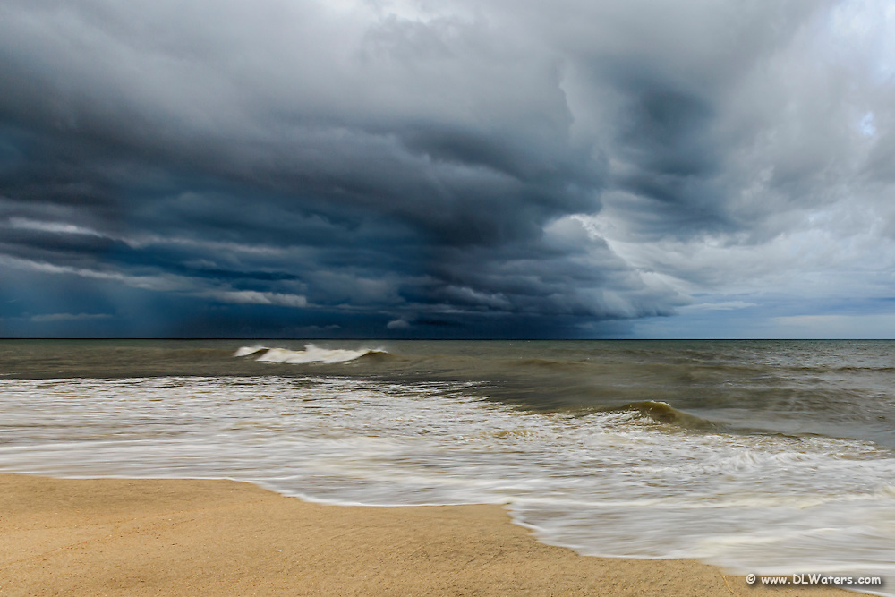 Dark storm clouds at sea on a Cape Hatteras beach.
