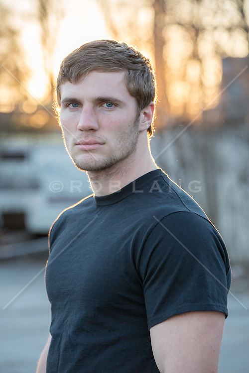 handsome All American man outdoors at sunset