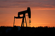©Randy Vanderveen© 2007 Randy Vanderveen, all rights reserved.Grande Prairie, Alberta.A pump jack is silhouetted against the pastel colours of the eastern sky before the sun rises above the horizon Wednesday morning east of Grande Prairie. Sunrise is beginning to take place noticeably later as August nears the halfway point.