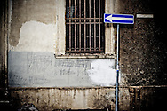 Scribbled graffiti and a one way sign in Jesi.