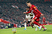 Liverpool forward Roberto Firmino (9) lines up for the shot  during the Premier League match between Liverpool and Manchester United at Anfield, Liverpool, England on 19 January 2020.