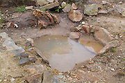 SAVEOCK WATER, CORNWALL, ENGLAND - AUGUST 02: A close up of Neolithic winter pool on August 2, 2008 in Saveock Water, Cornwall, England. A stone lined bath is inserted into the pool. Excavated by archaeologist Jacqui Wood and her team. (Photo by Manuel Cohen)