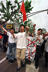 CHINA SHANGHAI 9MAY99 - Chinese demonstrators shout anti-NATO slogans and hold posters denouncing the U.S. in Shanghai May 9. Several thousand protesters gathered on Shanghai's streets today demonstrating against NATO's bombing of the Chinese embassy in Belgrade.       jre/Photo by Jiri Rezac          REUTERS