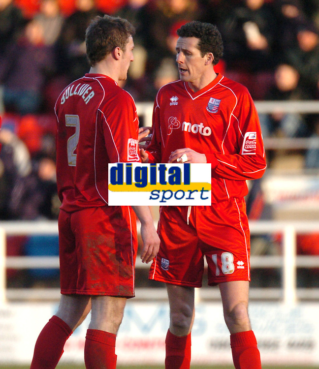 Photo: Ian Hebden.<br />Rushden & Diamonds v Grimsby Town. Coca Cola League 2. 04/03/2006.<br />Rushden player manager Barry Hunter (R) issues instructions to Phil Gulliver (L) after bringing himself on for the last few minutes.