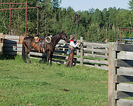 Photo Randy Vanderveen.Near Debolt, Alberta, July 22/08.A cowboy tied up his mount in a corral.