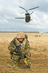 4 Mech Bde taking part in the Mission Specific Training on Salisbury Plain Training Area before deployment to Helmand Province Afghanistan. The RAF Chinook takes off with the simulated casualty safely on board while a  member of the Royal Dragoon Guards holds his position on the defensive perimeter  9 Feb 2010