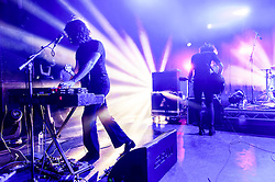 © Licensed to London News Pictures. 08/03/2014. London, UK.   Temples performing live at Shepherds Bush Empire. In this picture - Adam Smith (left), James Edward Bagshaw (right).  Temples are an English psychedelic rock band consisting of members James Edward Bagshaw (singer/guitarist), bassist Thomas Edison Warmsley (bass), Sam Toms (drums) and Adam Smith (keyboards/guitar/vocals).   Photo credit : Richard Isaac/LNP