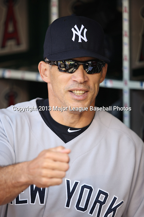 ANAHEIM, CA - JUNE 15:  Joe Girardi #28 of the New York Yankees does a fist bump with a player before the game against the Los Angeles Angels of Anaheim on Saturday, June 15, 2013 at Angel Stadium in Anaheim, California. The Angels won the game 6-2. (Photo by Paul Spinelli/MLB Photos via Getty Images) *** Local Caption *** Joe Girardi