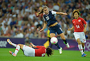 Wembley, Great Britain,..Description:USA Striker,  ALEX MORGAN, jumps over Saki KUMAGAI as she heads towards the Japanese goal during the USA Women's Football Team 2-1 win over Japan to win  Gold Medal at the 2012 London Olympic , Women's Football, Gold Medal Match at Wembley Stadium, USA vs Japan, .. ..21:00:55  Thursday  09/08/2012 [Mandatory Credit: Peter Spurrier/Intersport Images]