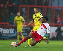 STEVENAGE, ENGLAND - Saturday, November 24, 2012: Tranmere Rovers' Liam Palmer in action against Stevenage's Anthony Grant during the Football League One match at Broadhall Way. (Pic by David Rawcliffe/Propaganda)