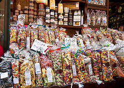 Colorful bags of  pasta as well as other local foodstuffs draw shoppers to Enoteca La Cambusa on via Cavour in Stresa's pedestrians-only shopping heart.