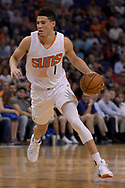 Mar 15, 2017; Phoenix, AZ, USA; Phoenix Suns guard Devin Booker (1) handles the ball in the first half against the Sacramento Kings at Talking Stick Resort Arena. Mandatory Credit: Jennifer Stewart-USA TODAY Sports