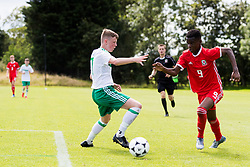 WREXHAM, WALES - Thursday, August 15, 2019: Wales' Japhet Matondo and Northern Ireland's Jack Paterson during the UEFA Under-15's Development Tournament match between Wales and Northern Ireland at Colliers Park. (Pic by Paul Greenwood/Propaganda)