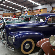 Vintage cars on display at Matthew's Vintage Collection  near Kaitaia.Northland, New Zealand. ..Matthew's Vintage Collection is a privately owned collection of vintage cars and machinery used in farming dating back to the early 1900's. Accumulated and restored by an avid vintage enthusiast over the last 40 years, covering over 1100 square meters of display area...Matthews Vintage Collection includes an extensive range of Farmall tractors covering a period from 1920's to 1950's as well as a variety of other makes..The selection of vintage cars including Nash's, Chevrolets and a Singer Roadster. Kaitaia Northland, New Zealand. 20th November 2010 Photo Tim Clayton..