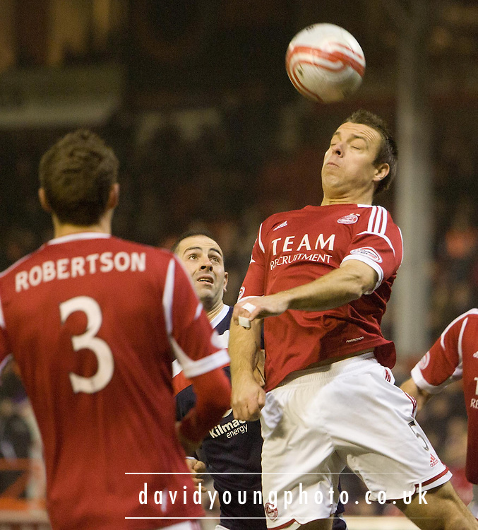 Aberdeen's Gavin Rae  heads clear - Aberdeen v Dundee, Clydesdale Bank Scottish Premier League at Pittodrie .. - © David Young - www.davidyoungphoto.co.uk - email: davidyoungphoto@gmail.com