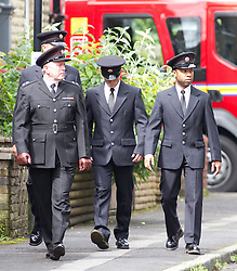 © Licensed to London News Pictures. 19/07/2012. Oldham , UK . The funeral of 2 year old Jamie Heaton , who was killed in a blast in his home on 26/06/2012 . Fire crew arrive to pay their respects . Photo credit : Joel Goodman/LNP