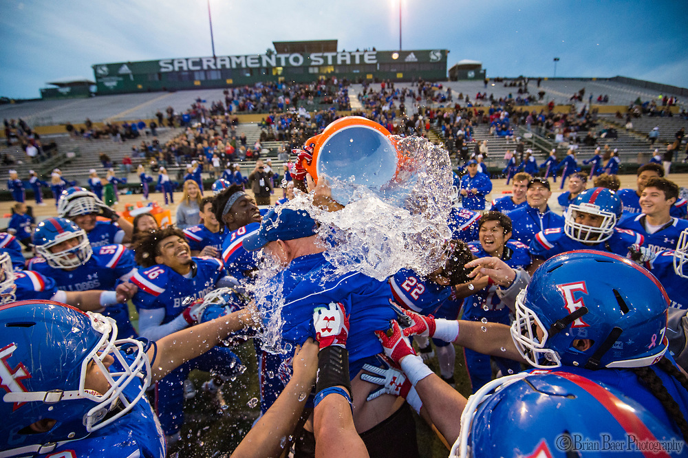 Folsom Bulldogs head coach Kris Richardson, is dunked with water after the game as the Folsom Bulldogs defeat the St. Mary's Rams 50-21 in the Sac-Joaquin Section Division I championship game at Hornet Stadium at Sacramento State, Saturday Dec 2, 2017. <br /> photo by Brian Baer