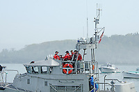 Coast Guard crew members prepare for a Memorial Day ceremony in Bar Harbor, Maine