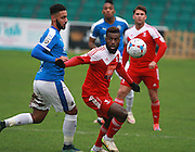 Whitehawk defender Chris Sessegnon gets the better of Dover striker Stefan Payne during the FA Trophy match between Whitehawk FC and Dover Athletic at the Enclosed Ground, Whitehawk, United Kingdom on 12 December 2015. Photo by Bennett Dean.