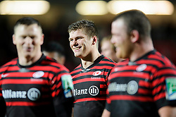 Saracens Fly-Half (#10) Owen Farrell is all smiles after his sides hard fought victory in the match - Photo mandatory by-line: Rogan Thomson/JMP - Tel: Mobile: 07966 386802 16/12/2012 - SPORT - RUGBY - Vicarage Road - Watford. Saracens v Munster Rugby - Heineken Cup Round 4.