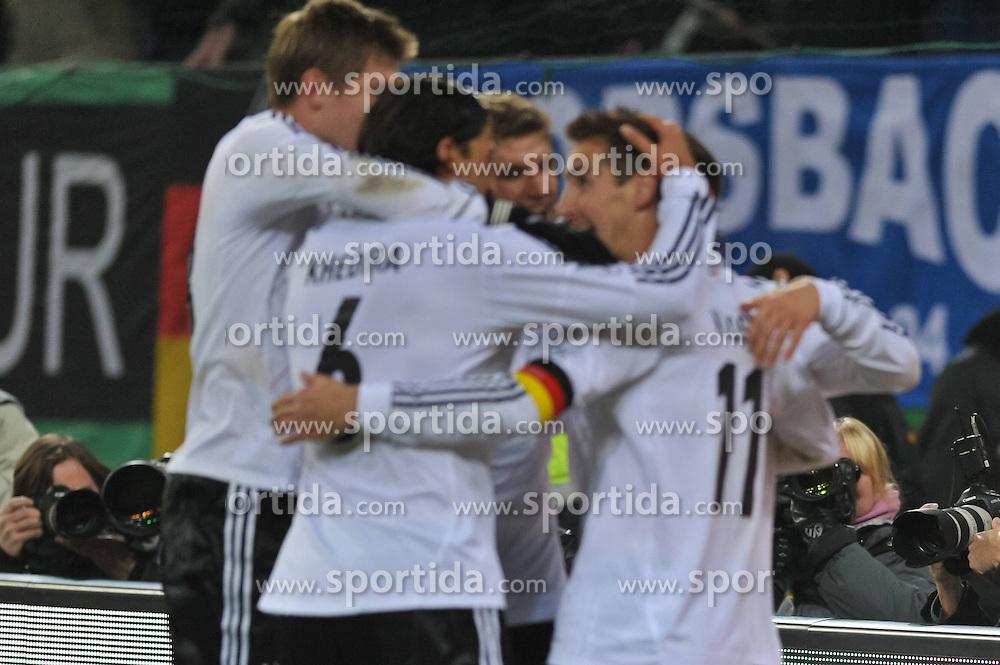 15.11.2011, Imtech Arena, Hamburg, GER, FSP, Deutschland (GER) vs Holland (NED), im Bild Mesut Oezil (Özil GER #08) schiesst das 3-0 und jubelt mit Thomas Mueller (Müller GER #13), Mats Hummels (GER #05) und Miroslav Klose (GER #11) // during the Match Gemany (GER) vs Netherland (NED) on 2011/11/15,  Imtech Arena, Hamburg, Germany. EXPA Pictures © 2011, PhotoCredit: EXPA/ nph/ Witke..***** ATTENTION - OUT OF GER, CRO *****