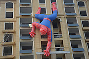ZAOZHUANG, CHINA - SEPTEMBER 21: <br /> <br /> Giant Inflatable Spiderman Dangles Headfirst off building<br /> <br /> A giant spiderman dangles headfirst on the wall of a residential building on September 21, 2016 in Zaozhuang, Shandong Province of China. The 10-meter-long inflatable spider was hung on the residential building by property developers to get more attention for their residential buildings.<br /> ©Exclusivepix Media