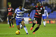 Reading's Garath McCleary holds off Queens Park Rangers midfielder Raniere Sandro during the Sky Bet Championship match between Reading and Queens Park Rangers at the Madejski Stadium, Reading, England on 3 December 2015. Photo by Mark Davies.