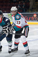 KELOWNA, CANADA - APRIL 3: Justin Kirkland #23 of the Kelowna Rockets checks a player of the Seattle Thunderbirds on April 3, 2014 during Game 1 of the second round of WHL Playoffs at Prospera Place in Kelowna, British Columbia, Canada.   (Photo by Marissa Baecker/Getty Images)  *** Local Caption *** Justin Kirkland;