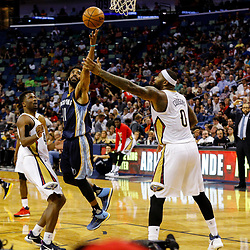 Mar 21, 2017; New Orleans, LA, USA; Memphis Grizzlies guard Mike Conley (11) shoots over New Orleans Pelicans forward DeMarcus Cousins (0) during the second quarter of a game at the Smoothie King Center. Mandatory Credit: Derick E. Hingle-USA TODAY Sports