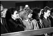 Funeral Of Eamon Andrews.   (R67)..1987..10.11.1987..11.10.1987..10th November 1987..Today saw the funeral of the broadcaster,Eamon Andrews. The funeral mass was held in St Anne's Church, Portmarnock, Co Dublin with the removal to Balgriffin Cemetery, Co Dublin...Image shows Mrs Grainne Andrews with her family Emma and Niamh at the mass for husband and father Eamon Andrews at St Anne's Church, Co Dublin.