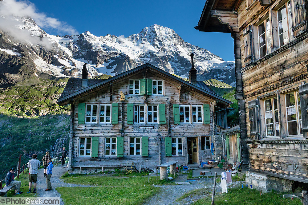We loved hiking to the quiet retreat of Berghotel Obersteinberg, which offers tremendous views of waterfalls and peaks in Upper Lauterbrunnen Valley, in the canton of Bern, Switzerland, Europe. Lit by candle light at night, this romantic escape built in the 1880s recalls an earlier era without power. The main luxuries here are flush toilets down the hall, and traditional Swiss hot meals. The private double rooms lack electricity, and bowls of water serve as bath and sink. Obersteinberg is a 2-hour walk from Stechelberg, or 4 hours from Mürren, in one of the world's most spectacular glaciated valleys. From Obersteinberg, don't miss the 2-3 hours round trip to the deep-blue tarn of Oberhornsee in the upper glacial basin, beneath snowcapped Grosshorn, Breithorn and Tschingelhorn. The Swiss Alps Jungfrau-Aletsch region is honored as a UNESCO World Heritage Site.